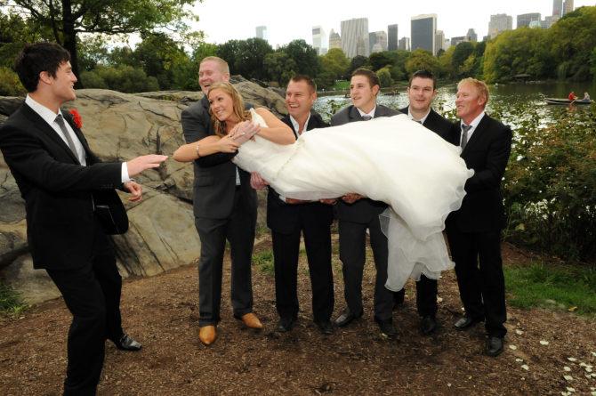 Groomsmen Lifting the Bride by: Kira Yustak