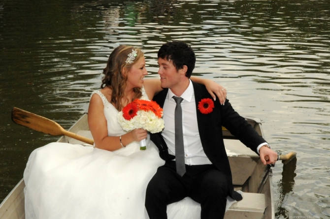 Bride and Groom on Rowboat by: Kira Yustak