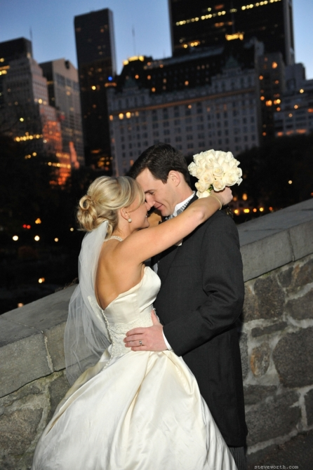 Bride and Groom on Gapstow at dusk by: Kira Yustak