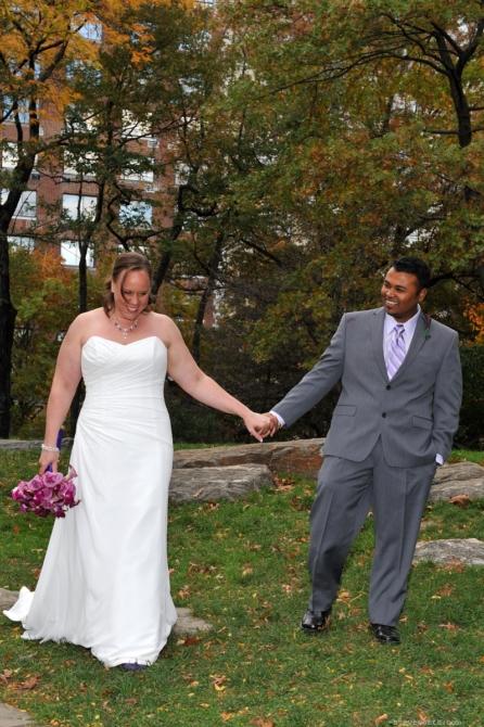Bride and Groom Walking by: Kira Yustak